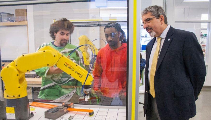Dr Pedraja observes robotics demonstration
